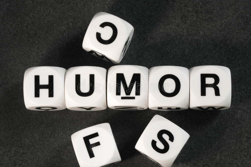Word humor on toy cubes. Word humor on white toy cubes royalty free stock image