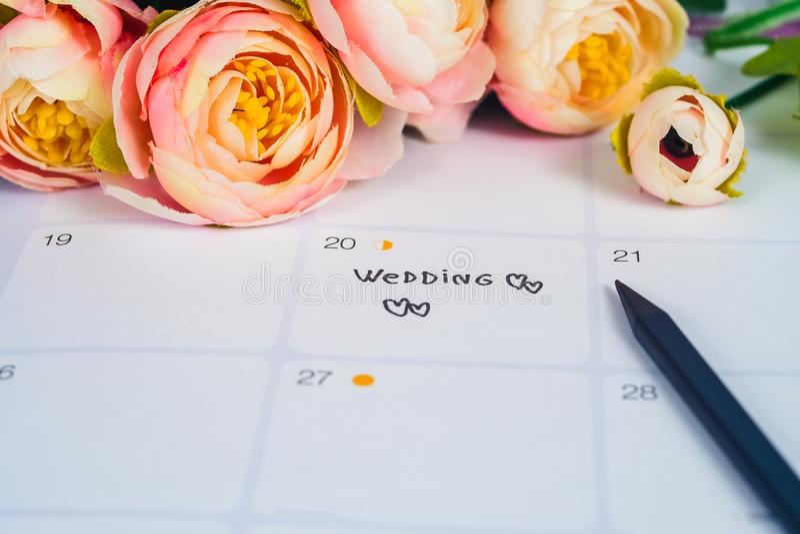 Word Huwelijk aan de dag van het Herinneringshuwelijk in kalender planning royalty-vrije stock afbeeldingen