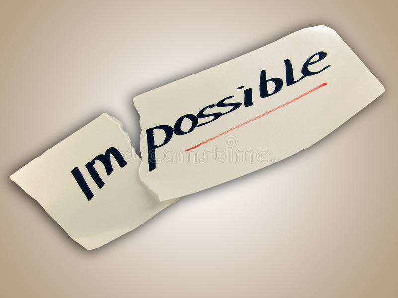 Word impossible transformed into possible. Motivation philosophy concept royalty free stock image