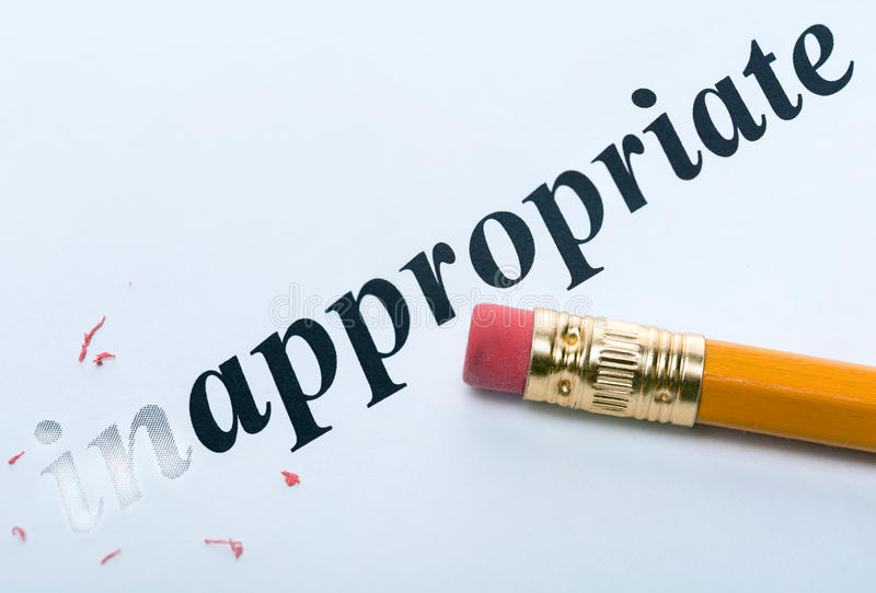 Word inappropriate appropriate. Word and pencil with eraser close-up Increased focus area stock images
