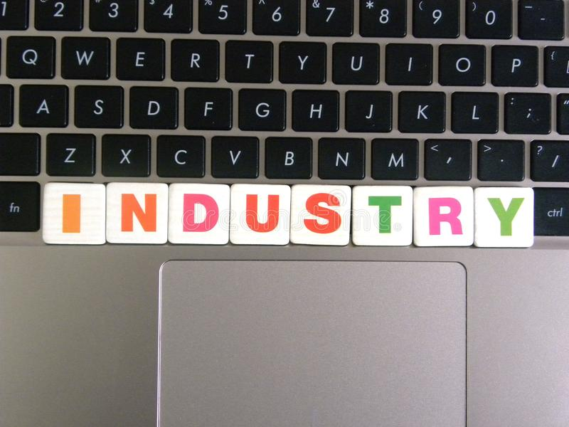 Word Industry on keyboard background.  stock photo