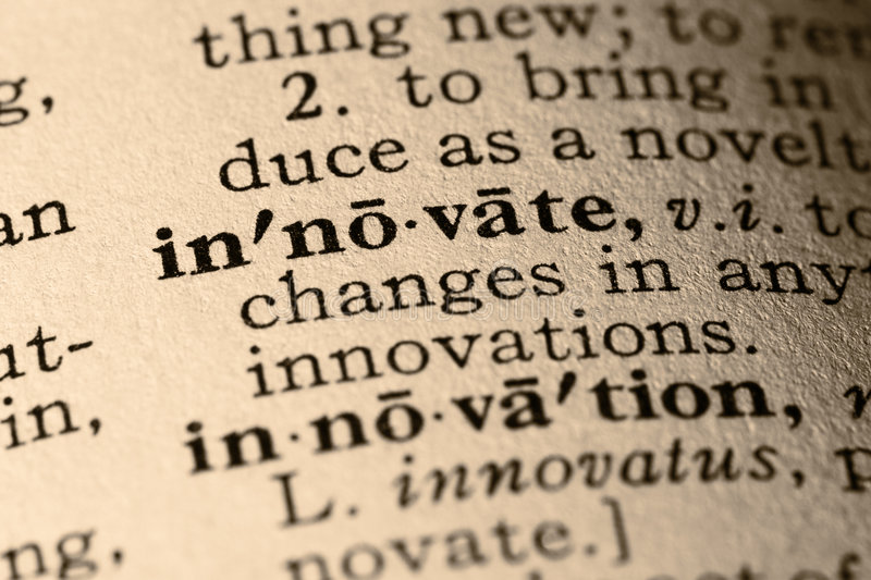 The word innovate. Close-up of the word innovate and innovation in a dictionary stock image