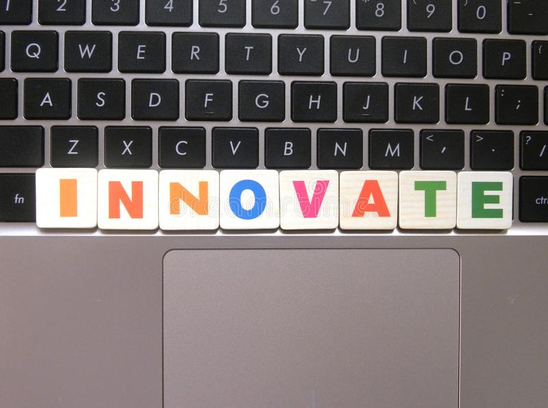 Word Innovate on keyboard. Background stock image