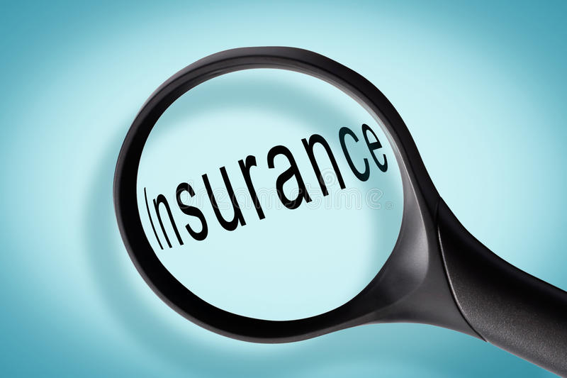 Word insurance seen through a magnifying glass royalty free stock image