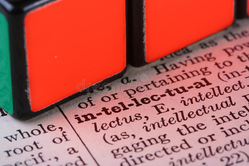 Word the intellectual. It is united with a cube a puzzle stock photo