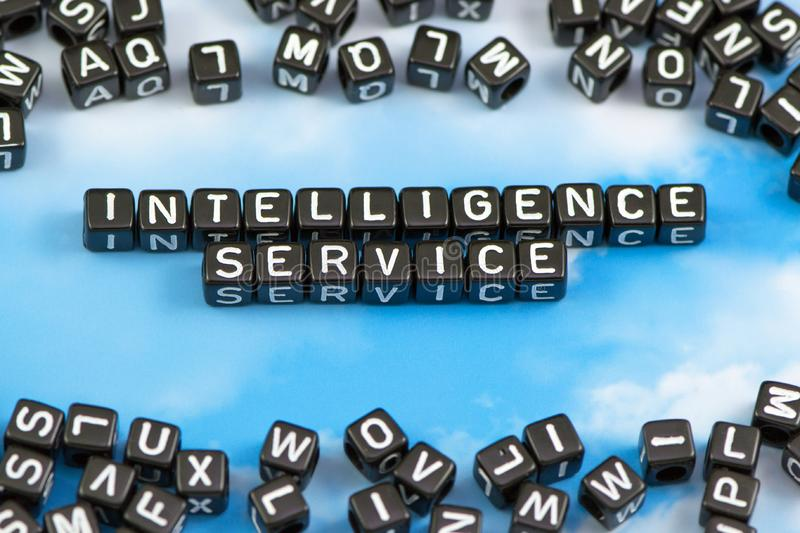 The word Intelligence service. On the sky background stock photos