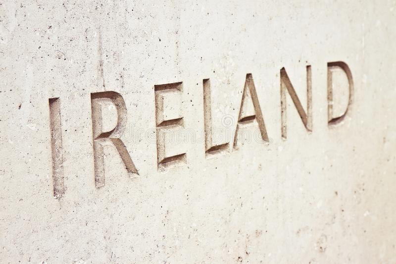 The word Ireland carved on stone wall - image with copy space royalty free stock photo
