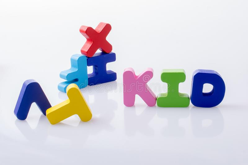 the word KID written with colorful letter blocks stock photo