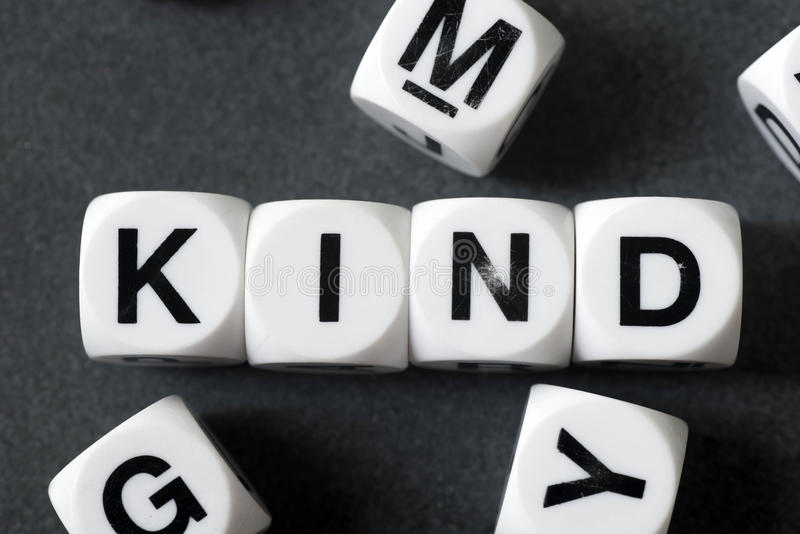 Word kind on toy cubes. Word kind on white toy cubes stock photos