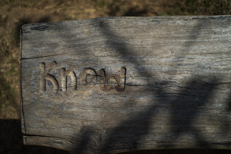 Word know carved in wood, on an wooden board, table top view wit stock images