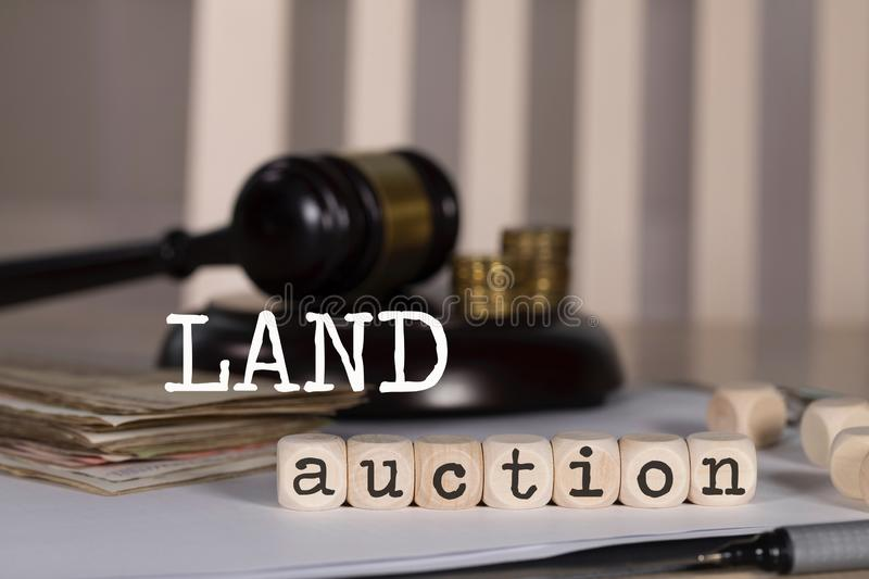 Word LAND AUCTION composed of wooden dices royalty free stock images