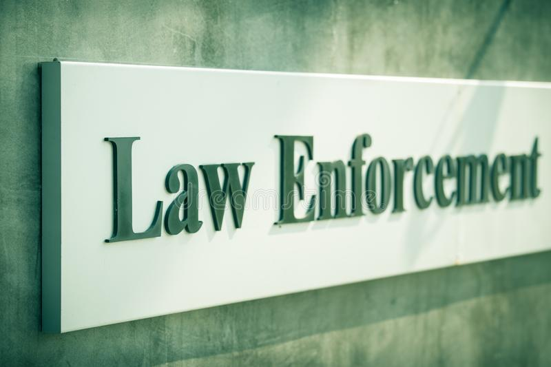 Word Law Enforcement on label decorate on wall in cinem stock photography