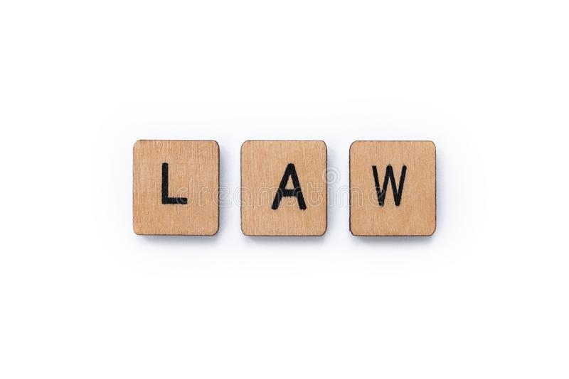 The word LAW. Spelt with wooden letter tiles over a white background stock photo