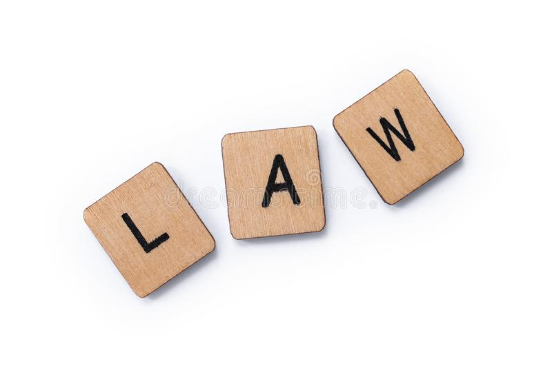 The word LAW. Spelt with wooden letter tiles over a white background royalty free stock photos