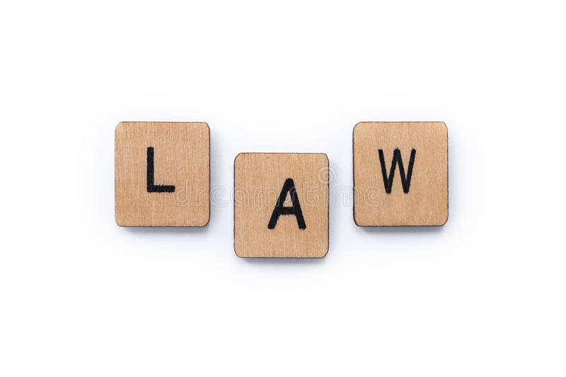 The word LAW. Spelt with wooden letter tiles over a white background royalty free stock images