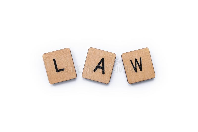 The word LAW. Spelt with wooden letter tiles over a white background royalty free stock image