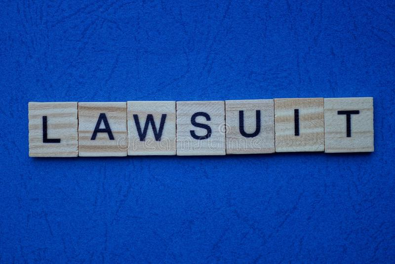 word-lawsuit-made-brown-wooden-letters-l