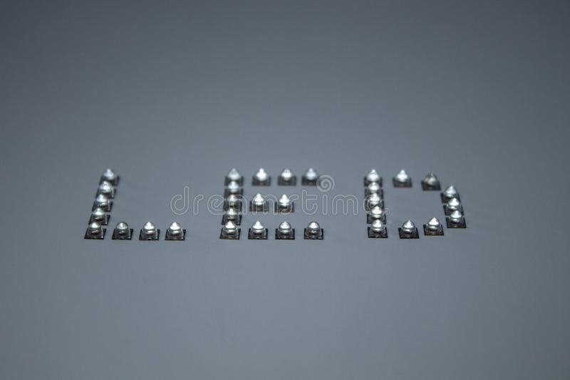 The word LED formed by actual LEDs. stock photo