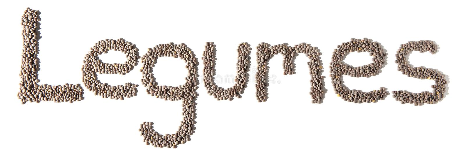 Word legumes written with lentils. Isolated over white background royalty free stock photography