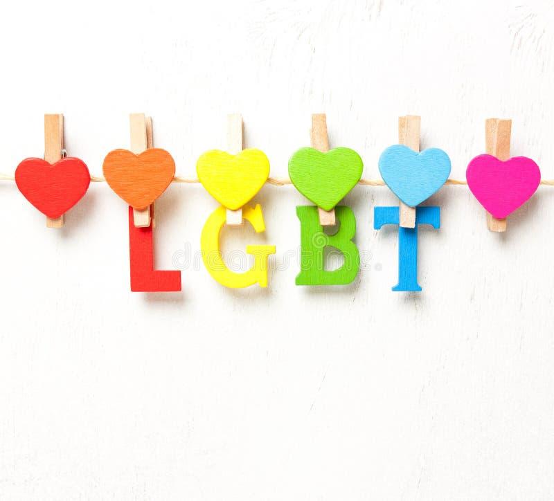 Word LGBT van multicolored brieven op een witte achtergrond stock foto's