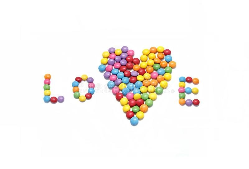 Word ``Love`` and abstract heart from bright colorful candy. Isolated on white background stock illustration