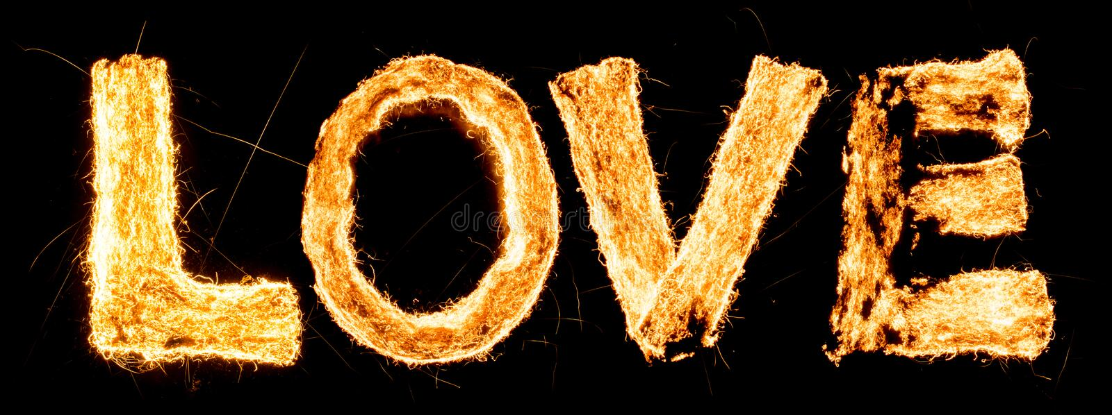 Word LOVE burning. Steel wool smoldering. Beautiful combustion. Exciting typography, font. stock photography