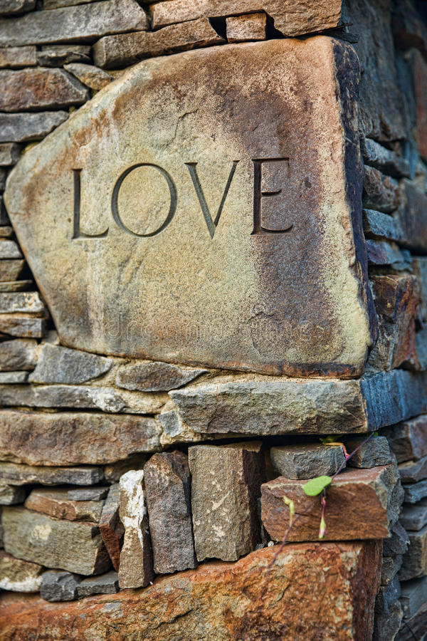 The Word Love Carved on a Stone stock image