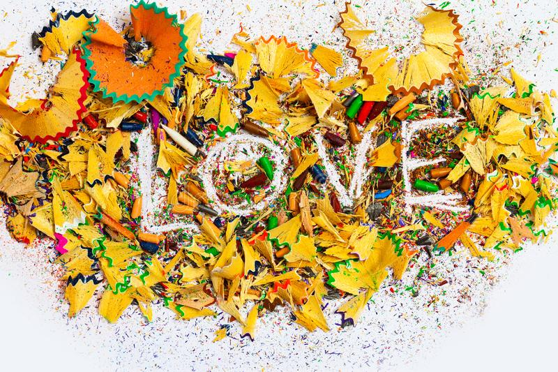The word Love on colored pencil shavings stock photo