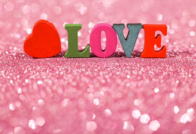 Word Love with Glittering Background. Colorful word Love with pink glittering background stock photos