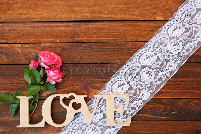 The word love and a heart with roses. On Valentine's Day royalty free stock photo