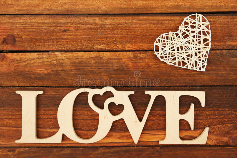The word love and a heart with roses. On Valentine's Day royalty free stock photography