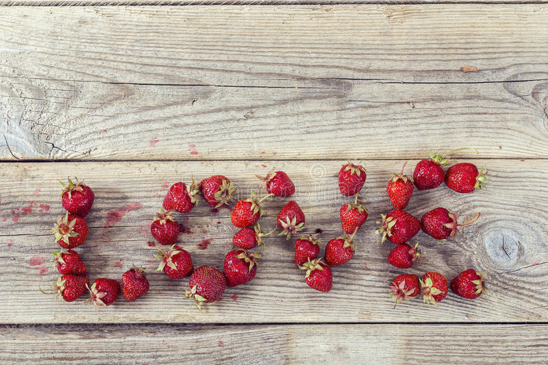 Word Love made of ripe strawberries. royalty free stock images