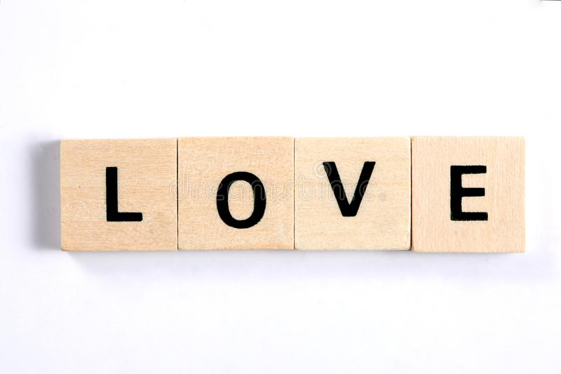 Word love written with wooden blocks isolated on white background royalty free stock photo