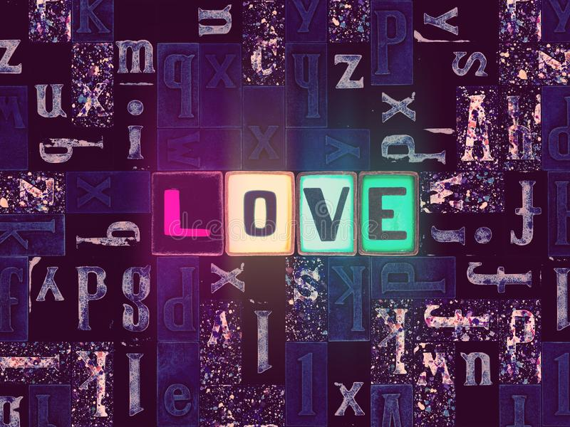 The word Love as neon glowing unique typeset symbols, luminous letters love. The word Love with neon luminous glowing, unique typeset letters abstract mosaic stock illustration