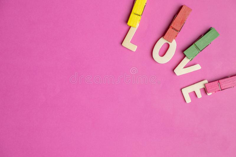 Word LOVE in red hearts on pink background, Love icon, valentine`s day, relationships concept. With copy space royalty free stock image