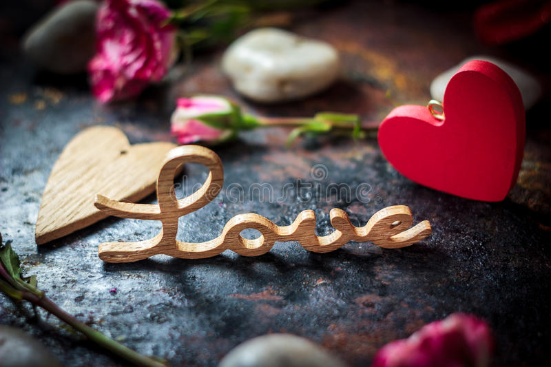 Word LOVE on rustic surface.  stock photography