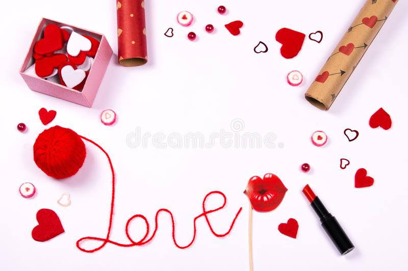Word love written with red wool thread and cute accessories stock photo