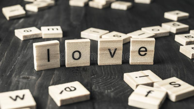 Word  love written on wooden blocks stock photography