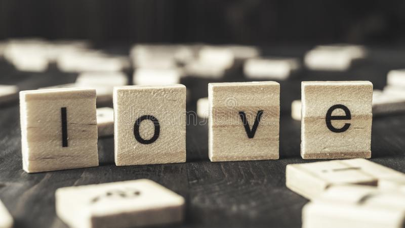 Word  love written on wooden blocks. Close up royalty free stock image