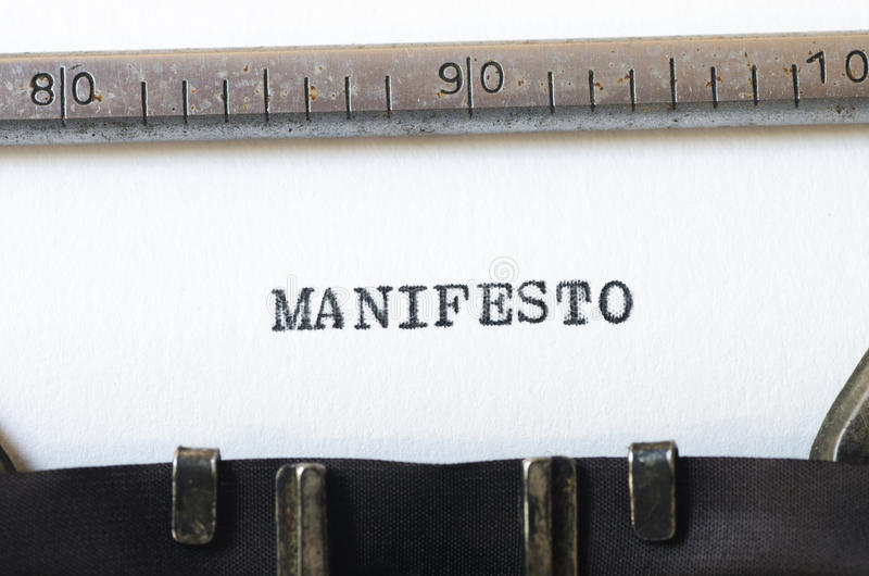 Word manifesto typed on typewriter. Word manifesto typed on old typewriter stock image