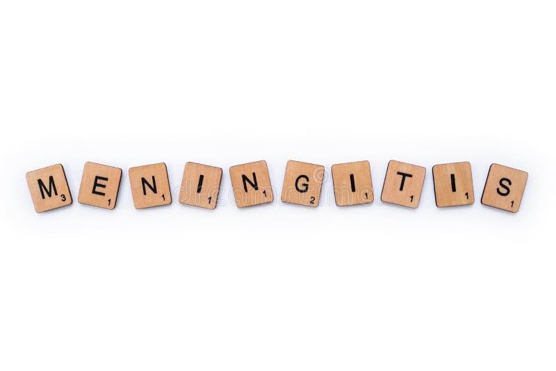 The word MENINGITIS. London, UK - June 16th 2019: The word MENINGITIS, spelt with wooden letter tiles over a white background. Meningitis is an infection of the stock images