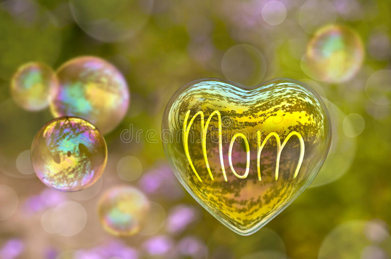 Word Mom written on a soap bubble in the shape of heart stock image