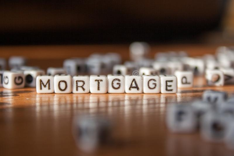 The word MORTGAGE made of white plastic blocks on the table. royalty free stock image