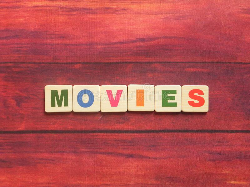 Word Movies. On wood background stock image