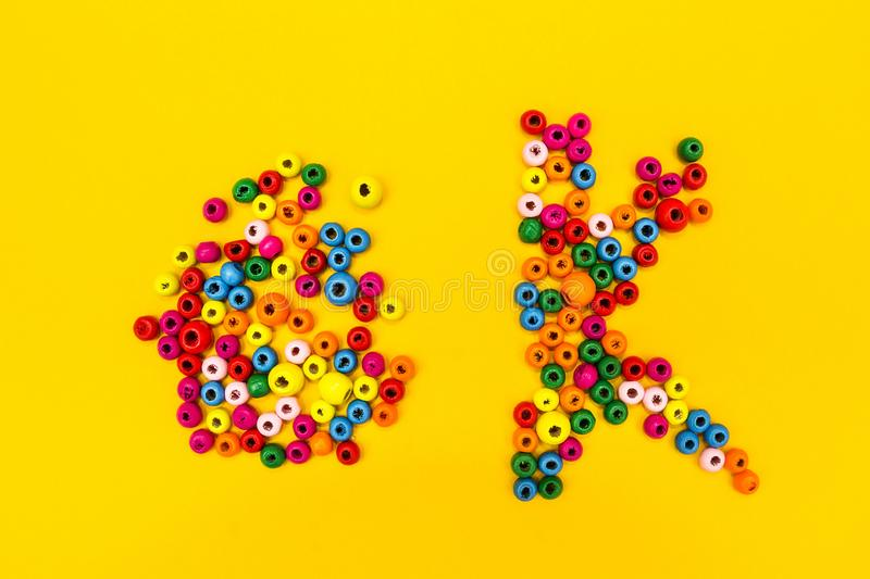 The word `ok` is from multi-colored round toys on a yellow background. stock photo