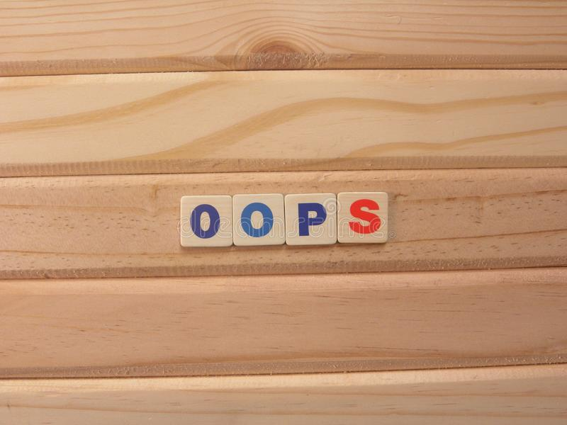 Word OOPS on wood. Background stock images