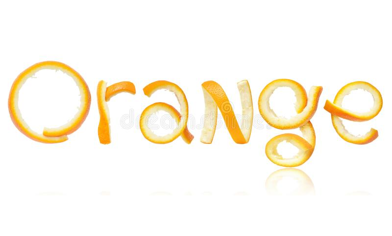 The word orange is made of peel, isolated on white background stock photography