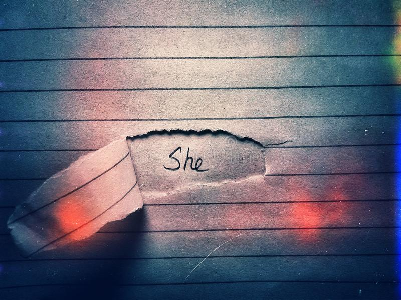 The word she on the page paper cut paper. Text, font, letter, female royalty free stock image