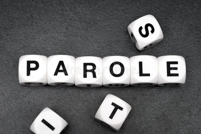Word parole on toy cubes. Word parole on white toy cubes royalty free stock image