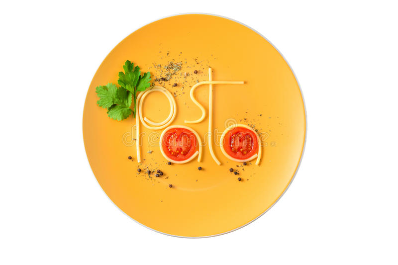 Word pasta made of cooked spaghetti on the plate isolated on white. royalty free stock photography